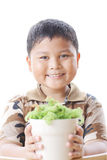 The boy is happy. With small trees Royalty Free Stock Photo