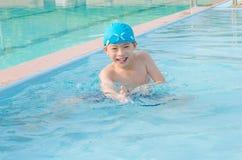 Boy happy at swimming pool Stock Photos