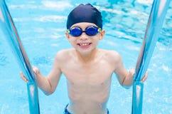 Boy happy at swimming pool Stock Photo