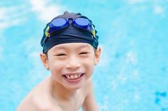 Boy happy at swimming pool Royalty Free Stock Photos