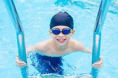 Boy happy at swimming pool Royalty Free Stock Image