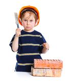 Boy in hard hat with brick Royalty Free Stock Images