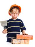 Boy in hard hat with brick Royalty Free Stock Image