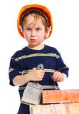 Boy in hard hat with brick Royalty Free Stock Photography