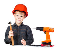Boy in hard hat with hammer and screwdriver Royalty Free Stock Photo