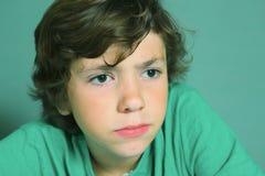 Boy hard thinking close up portrait Stock Photo