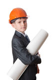 The boy in hardhat holds a roll of drawings Stock Image