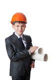The boy in hardhat holds two sheet of paper Stock Photography