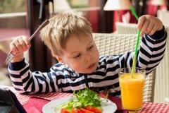 The boy has breakfast royalty free stock photos