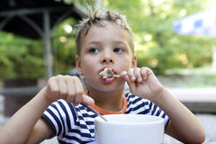 Boy has chicken soup. In a restaurant Royalty Free Stock Image