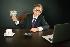 Boy has earned a lot of money Stock Images