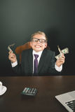 Boy has earned a lot of money. Banker holds in hand American dollars. Cunning business boy. Successful school boy. Happy. Success concept. Business suit. Stock Royalty Free Stock Image