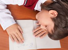 The boy has fallen asleep on a school desk Stock Images