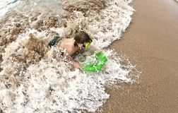 Boy has fun at the beach Royalty Free Stock Photography