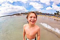Boy has fun at the beach Royalty Free Stock Images