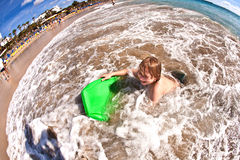 Boy has fun at the beach Stock Photo