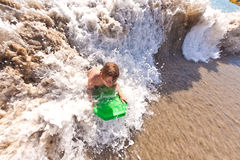 Boy has fun at the beach Stock Image