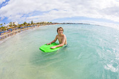 Boy has fun at the beach Royalty Free Stock Photo