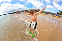 Boy has fun at the beach Stock Photography