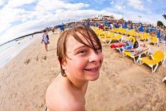 Boy has fun at the beach Royalty Free Stock Image