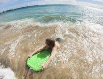 Boy has fun at the beach Stock Image