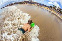 Boy has fun at the beach Stock Photos