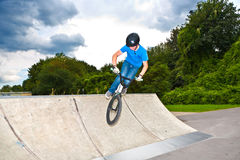 Boy has fun with his BMX at the skatepark Stock Images