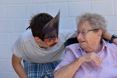 Boy has fun with his grandma Stock Photo