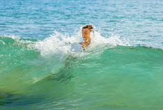 Boy has fun jumping in the waves Royalty Free Stock Photos