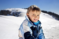 Boy has fun in the mountains. Happy boy has fun in the mountains Stock Image