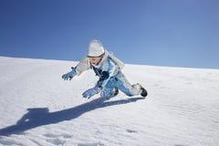 Boy has fun in the mountains, winter fun Royalty Free Stock Photo