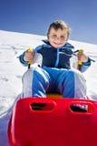 Boy has fun in the mountains Stock Photos