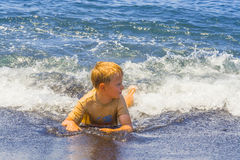 Boy Has Fun Playing In The Waves Stock Photography