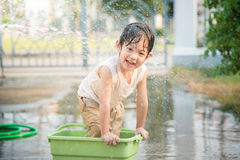 Boy has fun playing in water Stock Photo