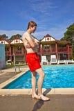 Boy has fun in the pool Stock Image