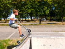 Boy has fun at the skate park Stock Photography