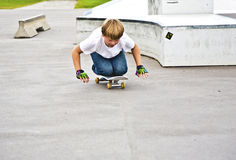 Boy has fun skating on knees Royalty Free Stock Photos