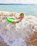 Boy has fun with the surfboard Stock Image
