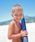 Boy has fun with the surfboard Stock Photography