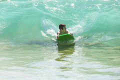 Boy has fun surfing in the waves. In Lanzarote royalty free stock photography
