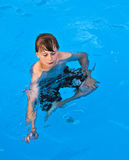 Boy has fun swimming in the pool Royalty Free Stock Photography