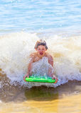Boy has fun in the waves of the ocean Stock Image