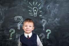 The boy has an idea drawn on the Board light bulb Royalty Free Stock Photography