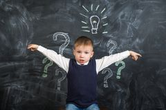 The boy has an idea drawn on the Board light bulb Royalty Free Stock Photo
