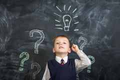 The boy has an idea drawn on the Board light bulb Stock Photography