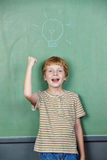 Boy has idea with lightbulb Royalty Free Stock Images