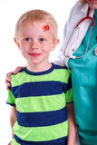 Boy has injury on forehead and gets help by the Doctor Royalty Free Stock Photo