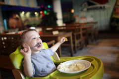 Boy has a lunch Royalty Free Stock Photos