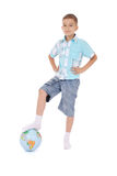 Boy has put a foot on the globe Royalty Free Stock Image