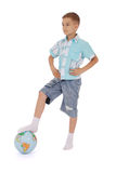 Boy has put a foot on the globe Royalty Free Stock Images